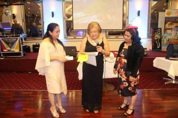 Marisa Vedar, GK Australia head,(right) and Jessica Yu, GK Provincial Head of Capiz (left) are with Lily Gillespie while she reads her thank you statement. GK thanked Gillespie for donating all proceeds of her birthday celebration organised by Sista Club led by Josie Young.