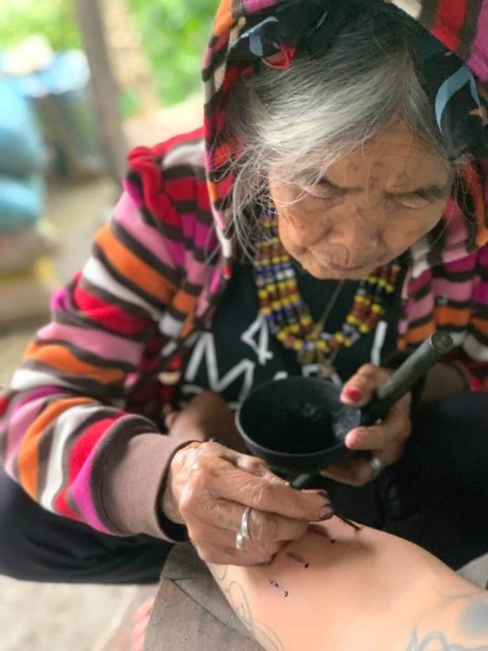 Apo Whang Od at work as tattoo artist