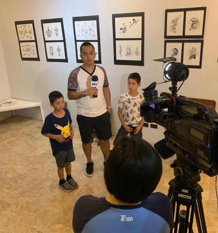 Opening of Christian Bulos' art exhibit being covered by PTV4
