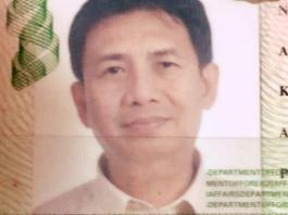 Raine's dad's last passport photo