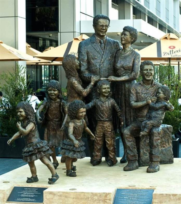 """""""Life from a suitcase"""" Life-sized sculpture of Biaggio and Fina Signorelli with their 7 grandchildren created by Terrance Plowright (Photo credit: Signorelli Family)"""