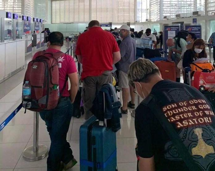 PAL passengers at check-ncounters | Photo: Gayzha Davao