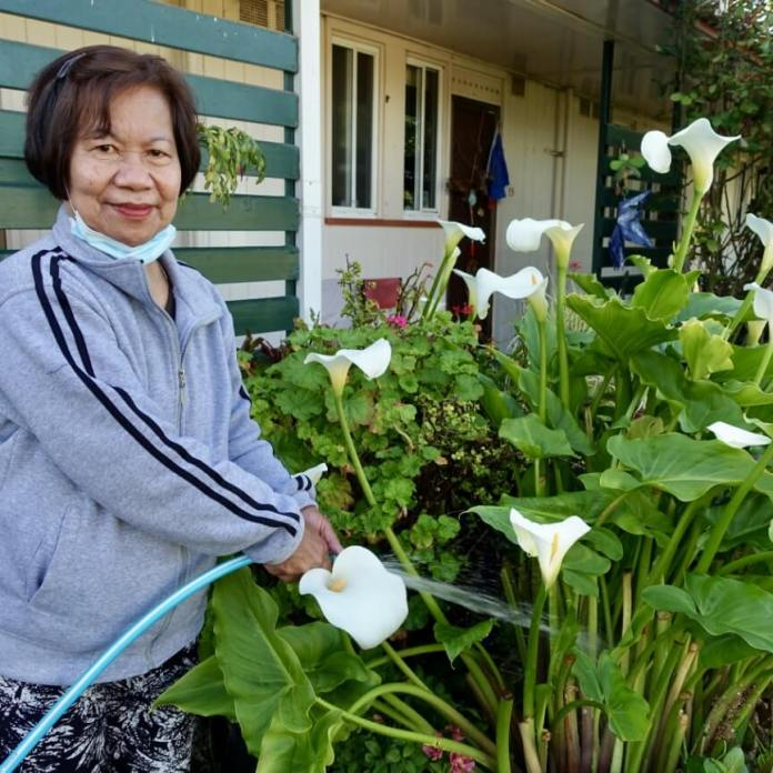Leonila enjoys looking after her garden, like many of the other residents. For her, watering the garden is an uplifting activity.