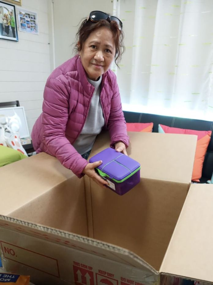 NELA has been busy gathering food and goods to pack into a balikbayan box. She hopes for the box to be delivered to her family in the Philippines in time for Christmas. | Photo: Jason Cordi