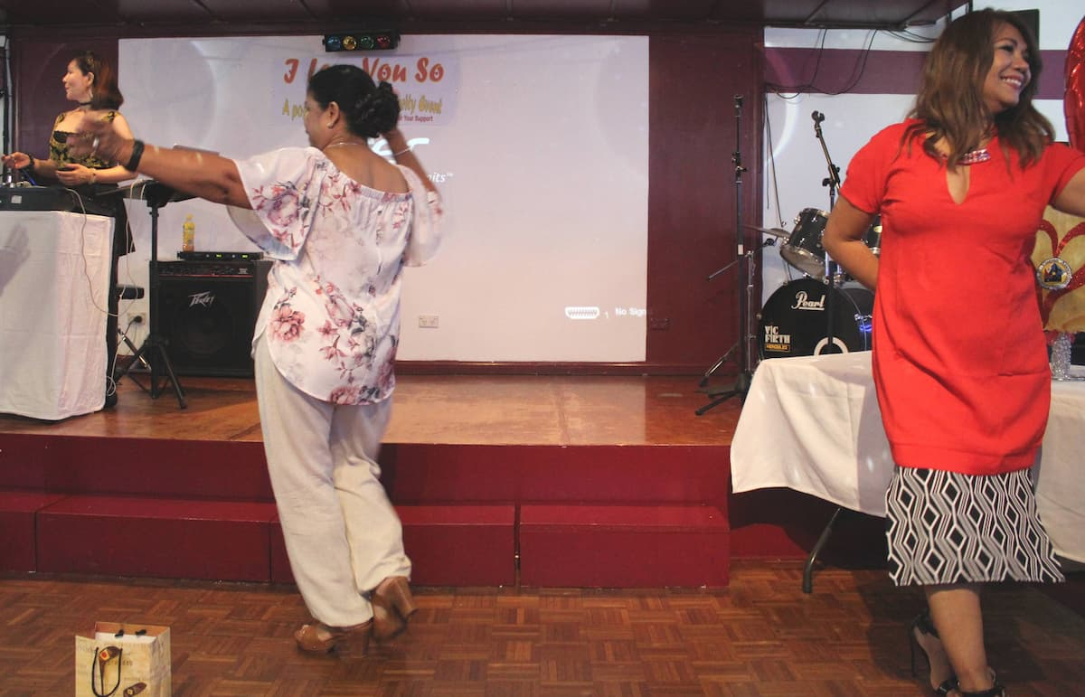 Dian Ford (left) and Fe Hayward (right) perform the Curacha dance