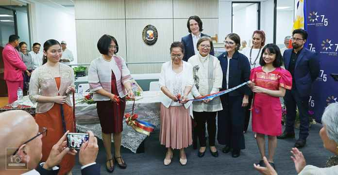 ConGen Maria Lourdes Salcedo and Lynda Magpayo (second and third from left) lead the ribbon-cutting ceremony. Behind them are Ambassador Ma. Hellen De La Vega and other VIPs.   PHOTO: Jess Marasigan