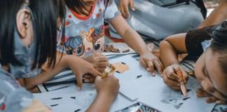 preschool kids drawing in day care