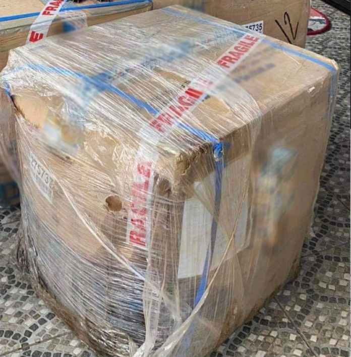 The Philippine counterpart of the balikbayan box company had to use plastic wrapper to prevent further dmage to the box during the transit. (Company logo of box blurred)