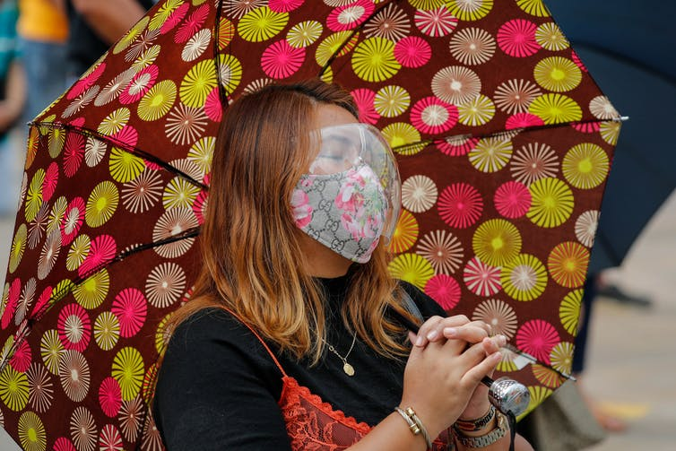 Filipino woman | PHOTO: Mark R. Cristino/AP