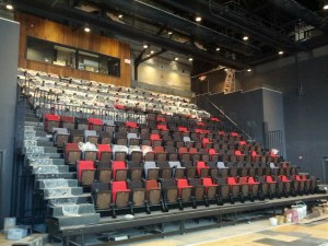 Seat installation in the new FringeArts theater at 140 N. Columbus Boulevard (Photo credit: Courtesy of FringeArts)