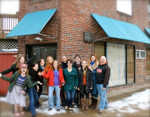 White Pines Productions' staff and ensemble in front of White Pines Place, Elkins Park (Photo credit: Courtesy of White Pines Productions)