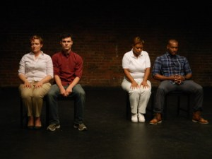 A scene from of the CHECKLIST by Renee Lucas Wayne, one of the highlights of 1MPF: (L to R): Meredith Sonnen (white mother), Arlen Hancock (her son), Lynne Bell (black mother), Chadwick A. Rawlings (her son). Photo credit: Seth Rozin.