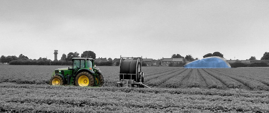 black and white field with tractor