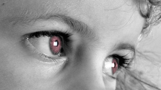 picture of young girls face with red eyes