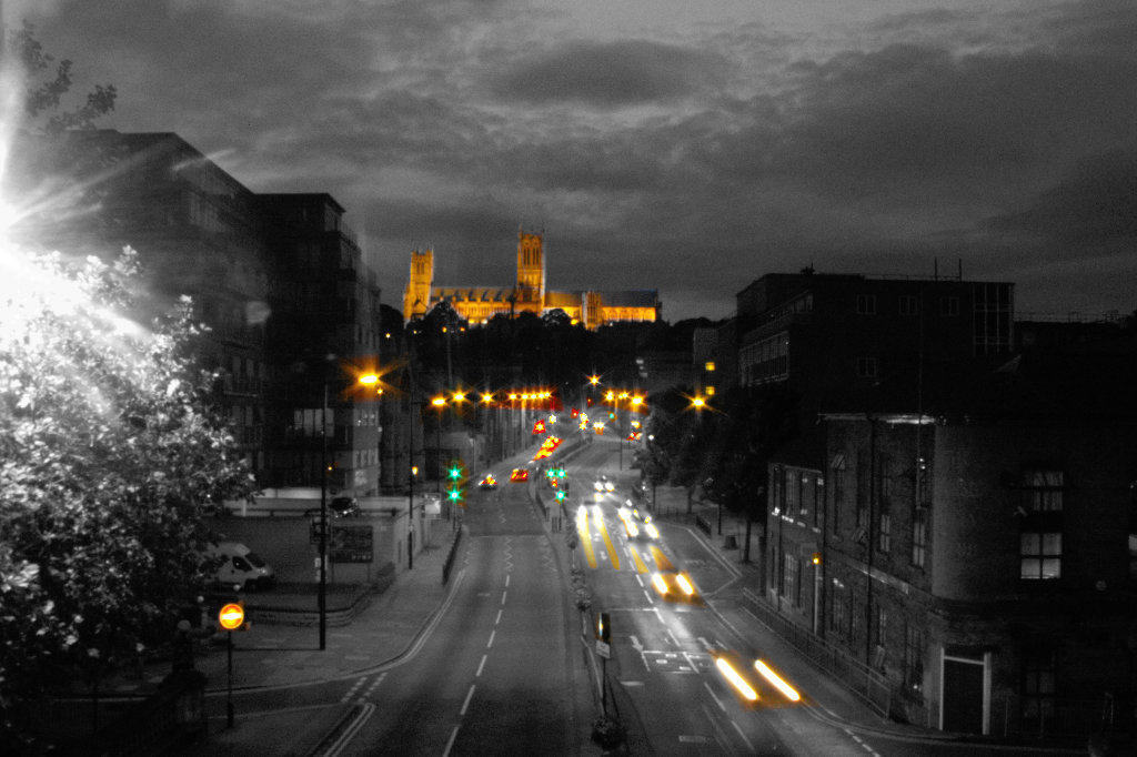 lincoln cathedral + lights from cars at night