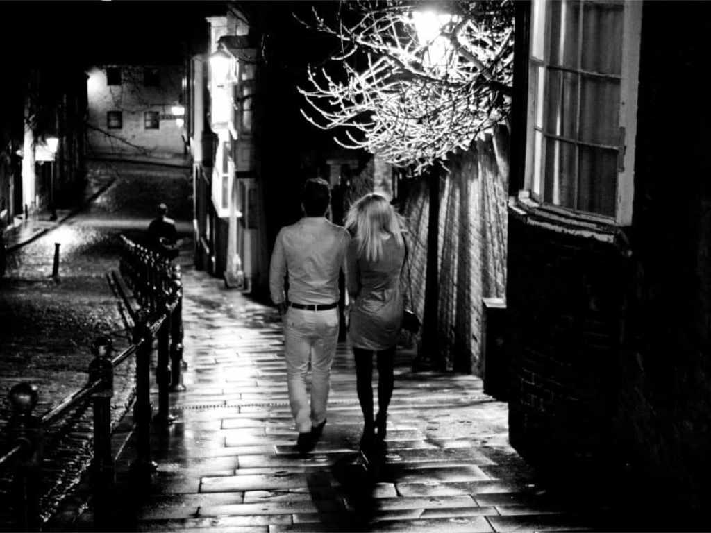 young couple on steep hill