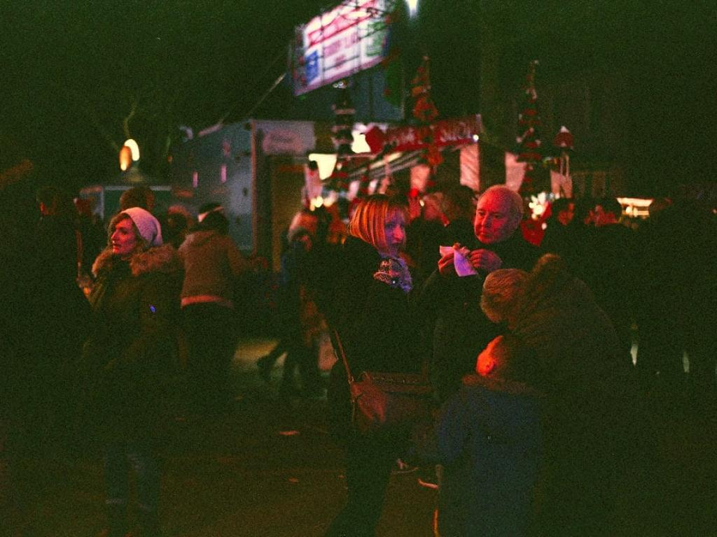 street photo of people from lincoln christmas market at night