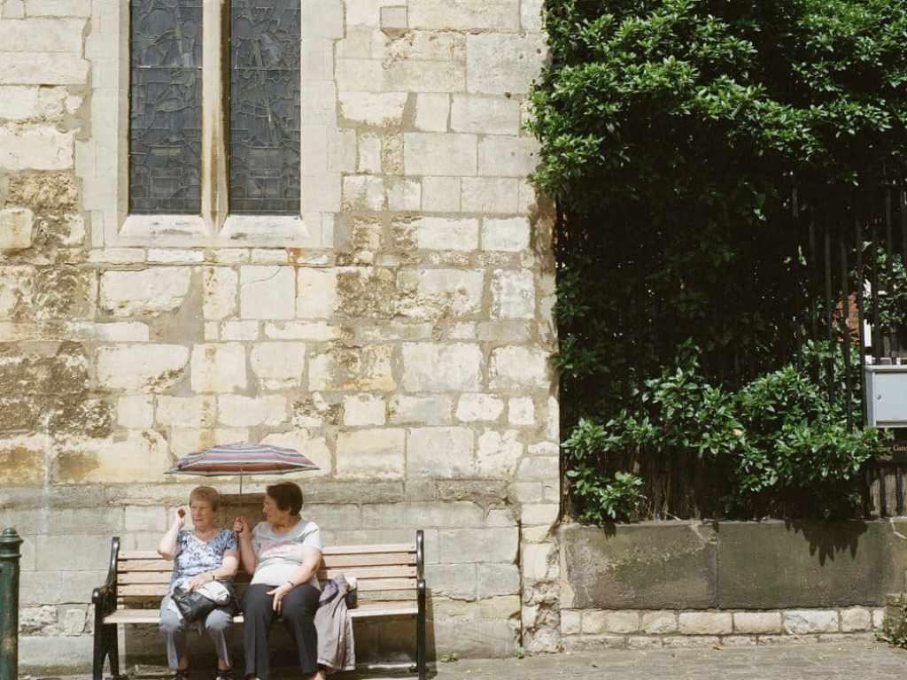 phlogger medium format shot of 2 old friends under umbrella