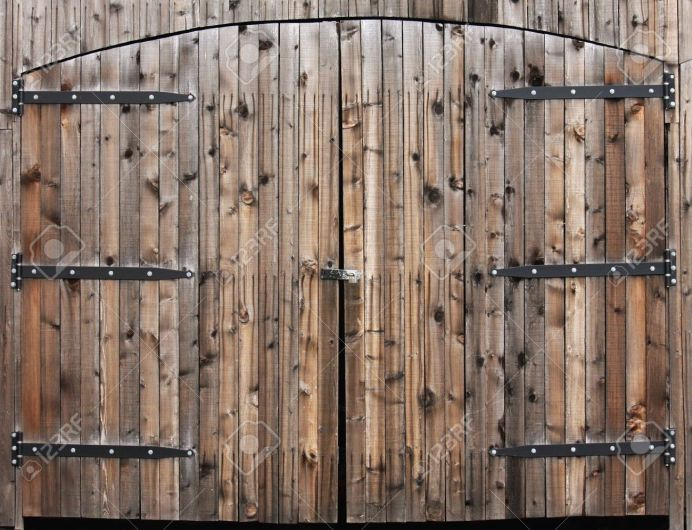 http://www.123rf.com/photo_4536242_pair-of-large-wooden-arched-doors-with-old-fashioned-hinges.html