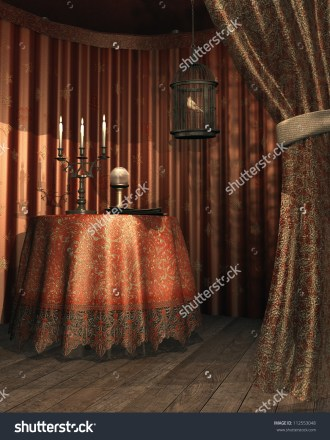 http://www.shutterstock.com/pic-112553048/stock-photo-fantasy-gypsy-tent-with-a-cage-table-candelabra-and-crystal-ball.html