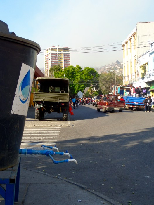 A water tank for the public, a military truck and a pickup truck. After President Michele Bachelet announced a state of emergency for the city, the military was called in.