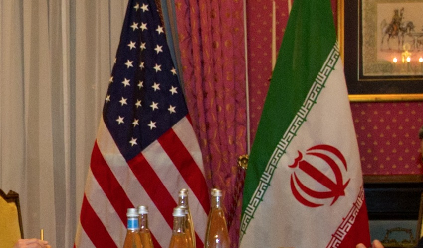 US and Iranian flags side by side
