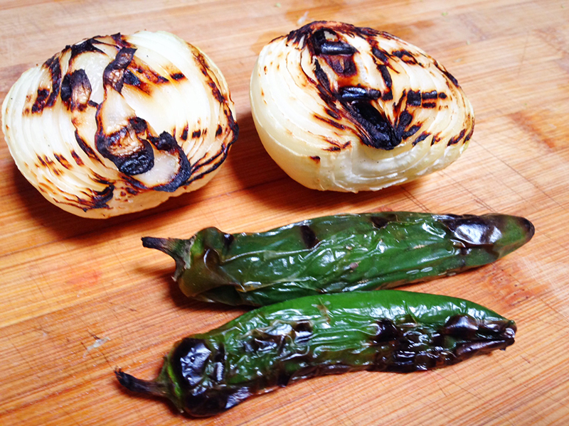 Charred onions and serrano peppers