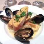 """Provencal Sunshine"" - a dish of halibut, shrimp, mussels, and monkfish."