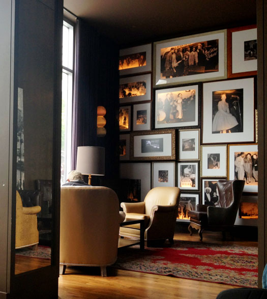 The city's light sweeps in to illuminate the 'Heritage Wall' in the restaurant's lounge on this rainy morning