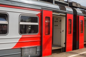 Image of a train stopped at a station with the doors open