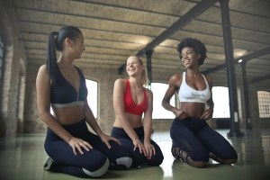 Image of three women wearing yoga clothes