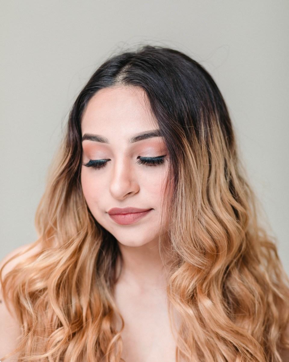 latina makeup look with long eyelashes