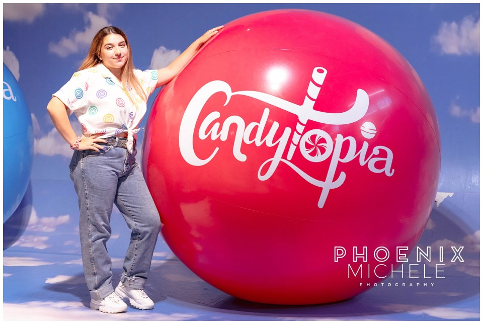 lady with red Candytopia balloon
