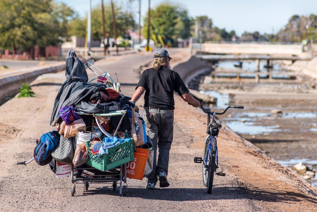 Homeless near canal in Phoenix Arizona, homelessness