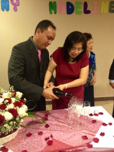 Tardas and Lenny pouring out wine for the toast