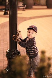 chris hugging another pole