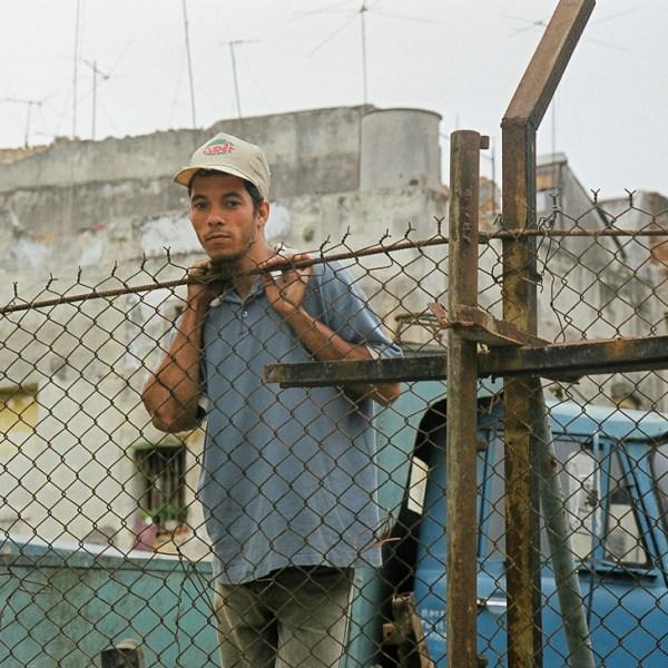 Man at Fence, Havana, Cuba, 1999 ©Cyndie Burkhardt.