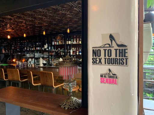 Restaurant sign saying no to sex tourism, Medellin,  Colombia