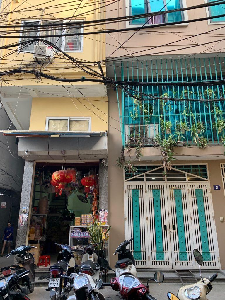 Black noodles in a crowded neighborhood, Hanoi, Vietnam ©2019, Cyndie Burkhardt.