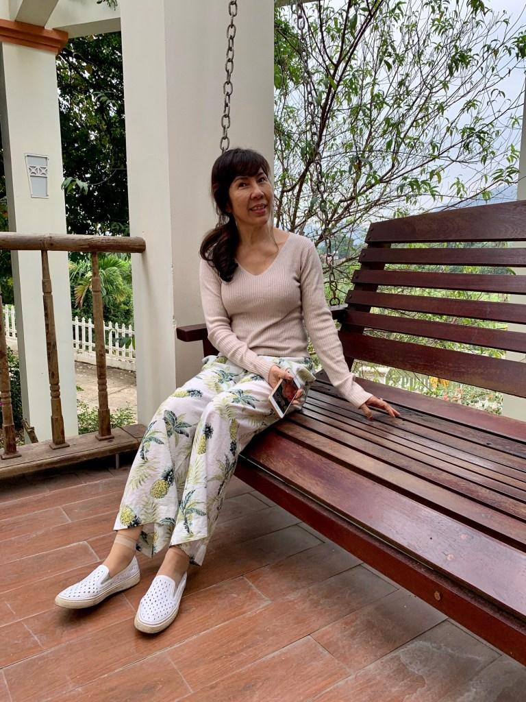 Ta sitting in her favorite part of the house, Hanoi, Vietnam ©2019, Cyndie Burkhardt.