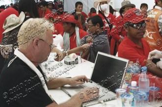 John Le Fevre surrounded by red-shirt protesters donating blood at Phan Fa Bridge, Bangkok, 2010