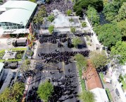 This photo from a camera drone captures tear gas exploding in front of anti-government protesters in Bangkok