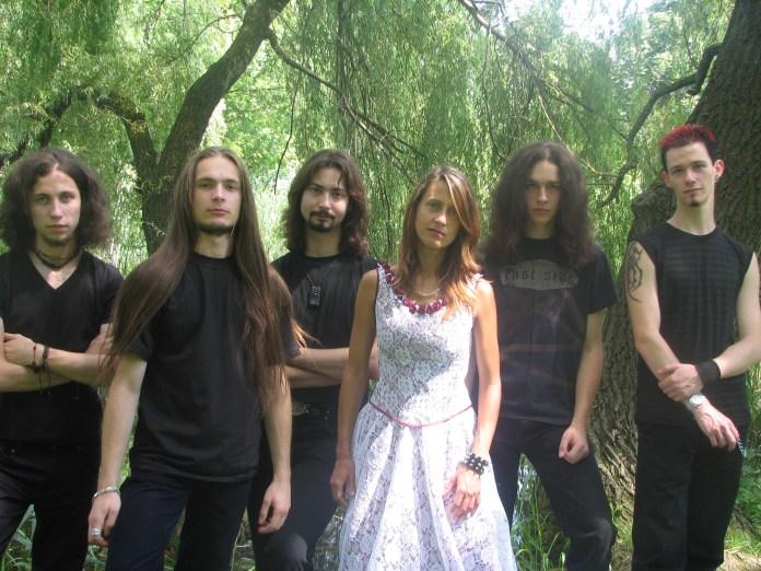учасники гурту в місцевості, поблизу Олеського замку