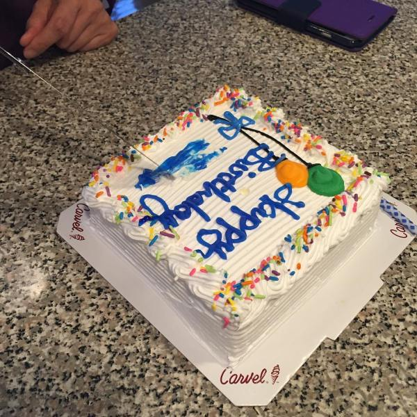 Smear the name before you cut the cake. For good luck. ?