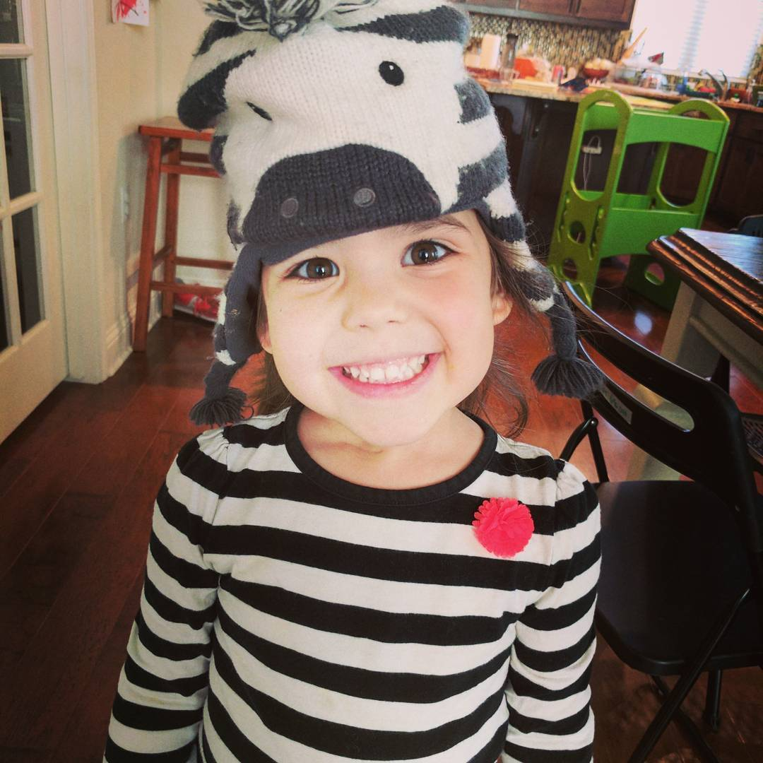 She thought her shirt looked like a zebra so she found an old zebra hat. She's been running around the table as a zebra for 10 or so minutes now.