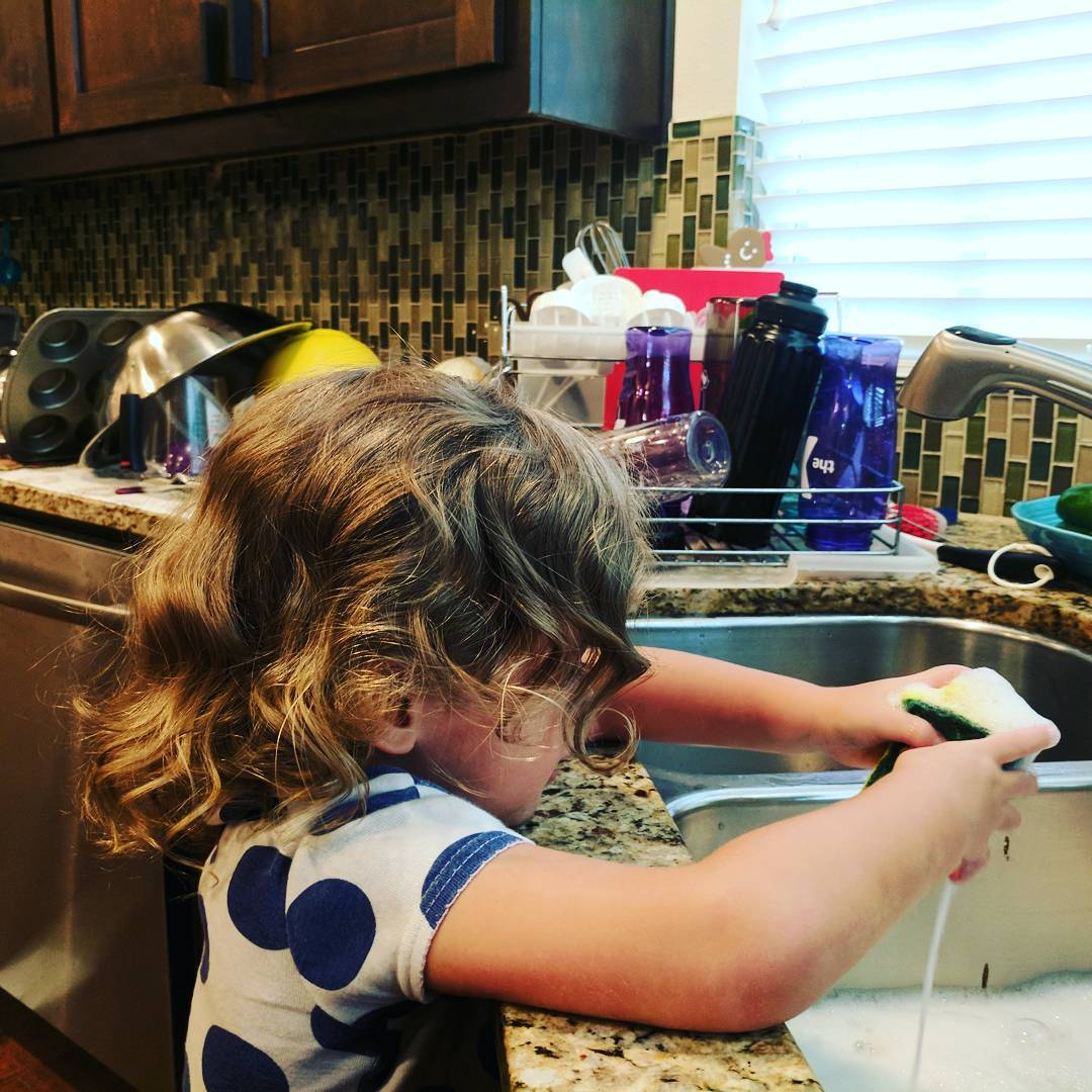 Putting her to work. Look at all those dishes she cleaned!