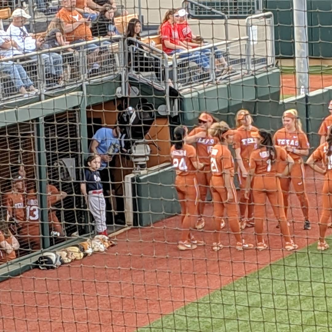 Olivia hanging out with the UT softball team. As one does