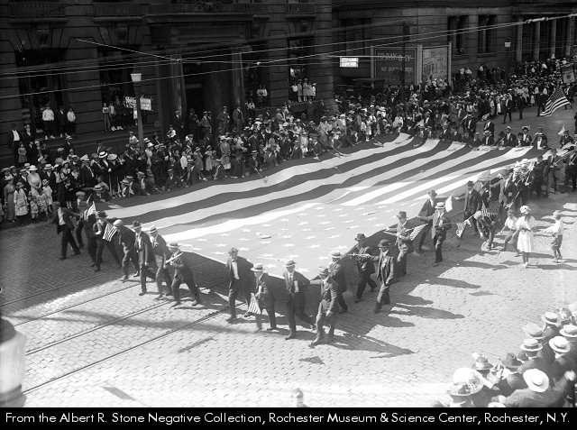 Members of the Silver Platers and Metal Polishers Union carry a large flag in Rochester's (New York) 1918 Labor Day Parade. A poster depicting Uncle Sam can be seen to the rear of the marchers. Albert R. Stone Photo Collection, Monroe County Library System