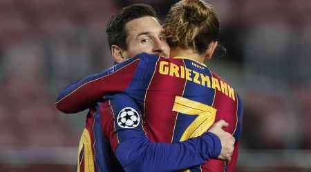 Antoine Griezmann celebrates with Leo Messi (Reuters)