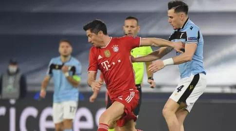Robert Lewandowski tries to break free from Patrick (Reuters)